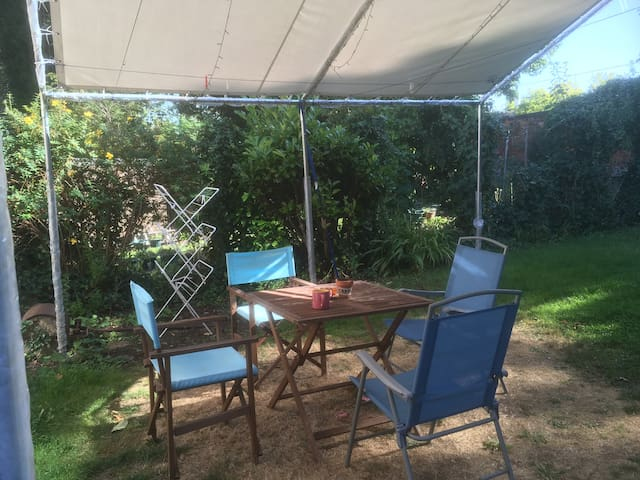 Our 'Eco tent' serves a dual purpose as it keeps the laundry out of the rain and it is a lovely place for our guests to 'hang out'