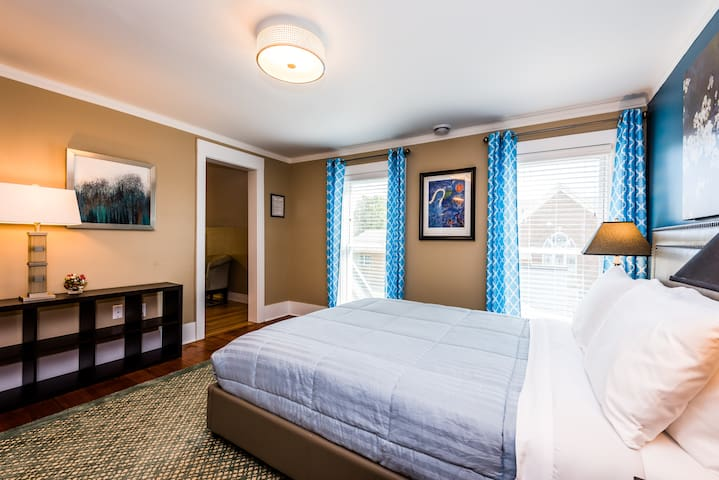 Bedroom Suite 4 - 2nd floor with queen beauty-rest luxury plush bed, separate sitting room with quality queen sofa sleeper, comfortable upholstered furnishings, flat panel TV/cable, WiFi and more.