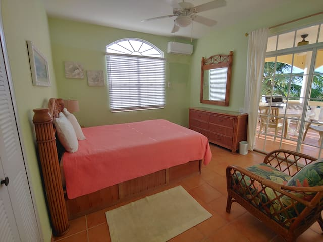 1 of 2 bedrooms on 1st floor  with view of patio.