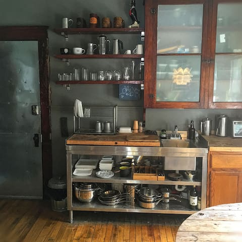 custom kitchen. vintage meets industrial. NOTHING is cookie cutter in this house. basic range. fridge. toaster oven. electric water kettle, french press coffee pot, etc. no microwave. lots of pots & pans for cooking if desired.no dishwasher.