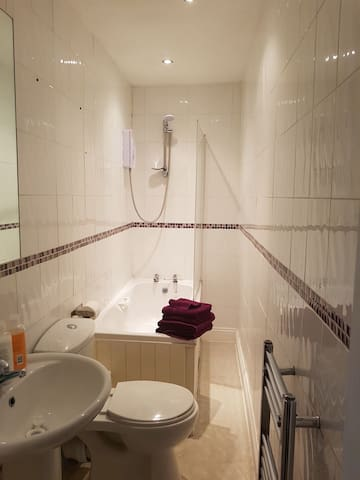 Bathroom with instant heat shower.