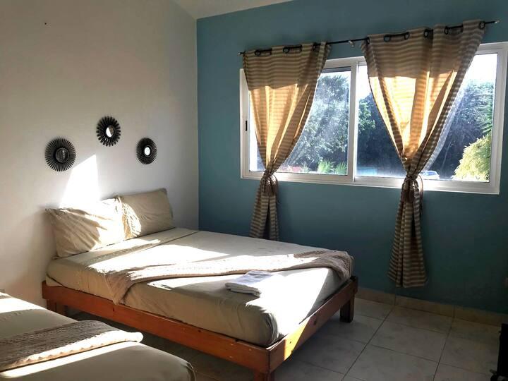 Lovely bedroom, 2 queen size beds.300m beach