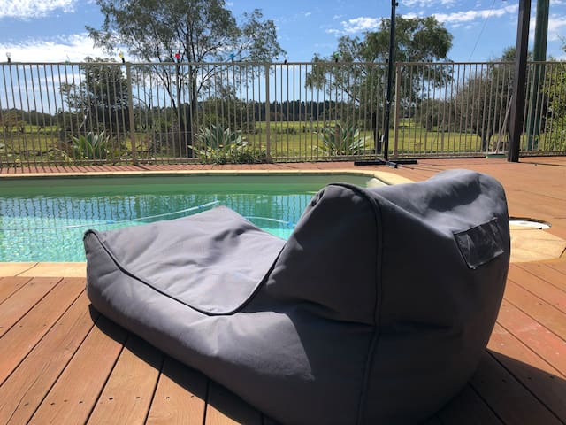 Relax by the pool when the weather permits.