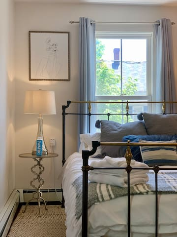 The queen bedroom includes window AC and a ceiling fan so you can make yourself comfortable.  Black out curtains and ear plugs are provided in each bedroom.  There's a large closet to hang your clothes, too!
