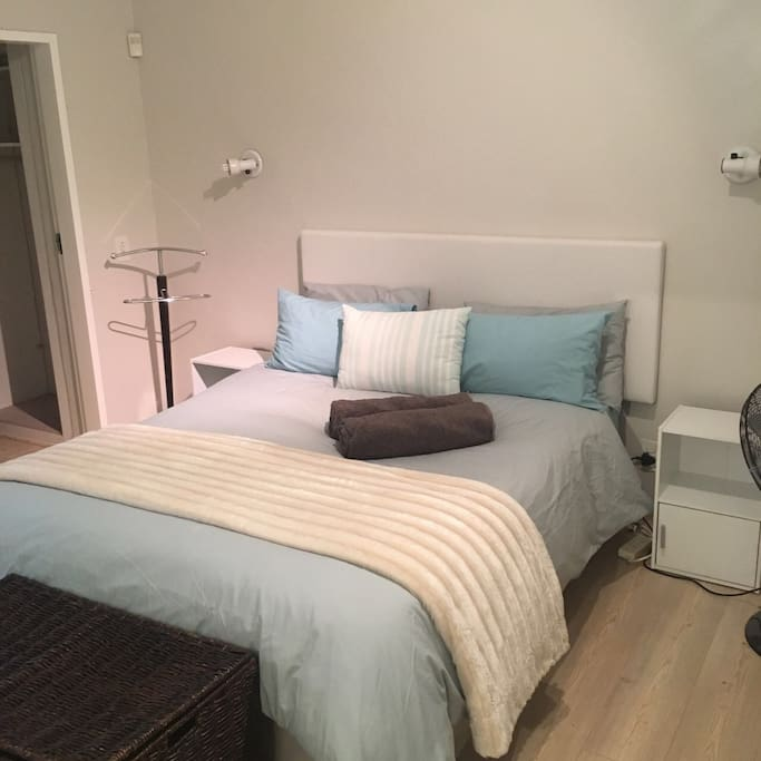 The main bedroom has an extra length queen sized bed and large walk in wardrobe