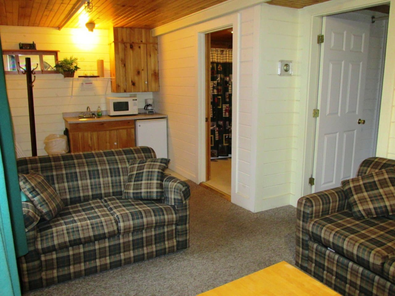 This suite has a kitchenette with refrigerator, microwave, sink and coffee maker.