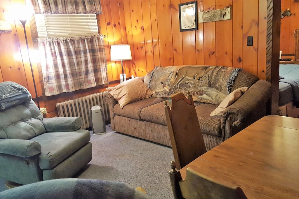 Recliner and queen sleeper of kitchette suite