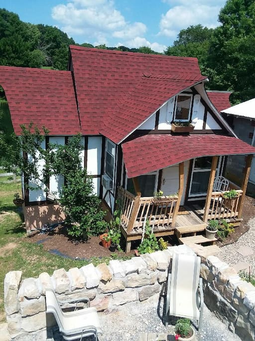 Another view of the cottage- there is a seating area in front the cottage (in addition to the private back deck.)