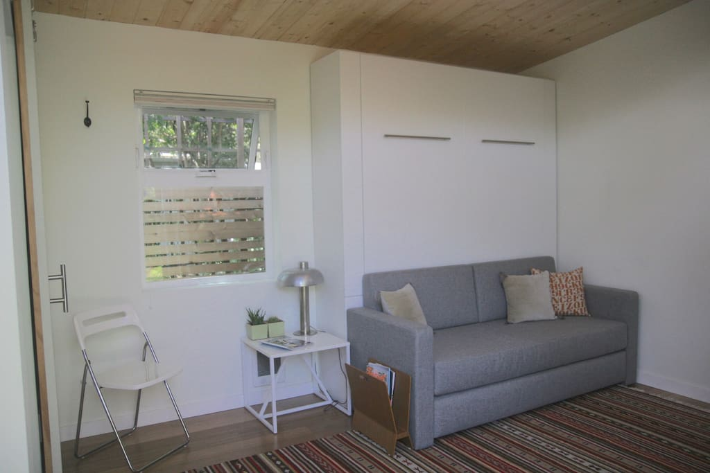 Bright and airy interior with clerestory windows and shades for privacy