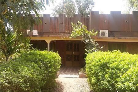 Chambre dans maison charmante Wemtenga - Ouagadougou