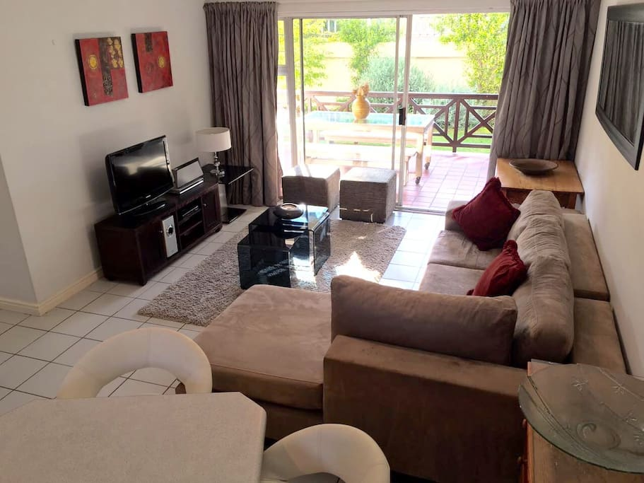 Lounge with satellite tv, DVD player and music station.