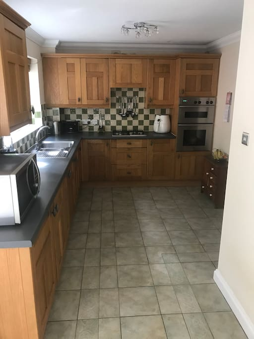 Large Kitchen with integrated fridge, freezer, dishwasher, gas hob and oven.Washing machine and drier housed in the utility.