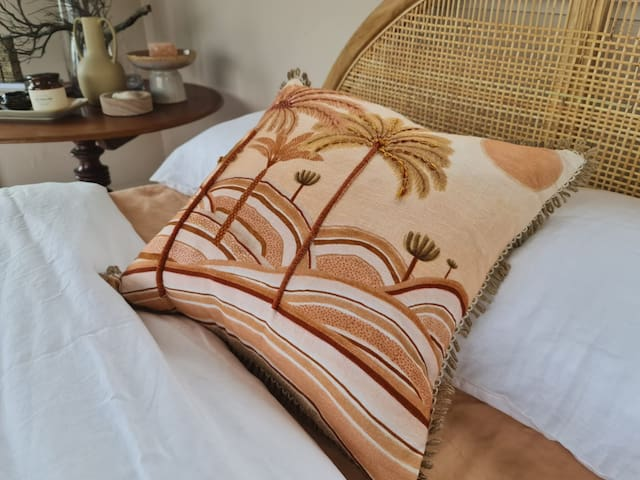 ROOF TOP BEDROOM.... The master bedroom is located on the third level and styled with cane and soft natural linen. Enjoy your own rooftop terrace and views of the ocean from the room. Fall asleep watching the sun set, a perfect way to unwind and escape.