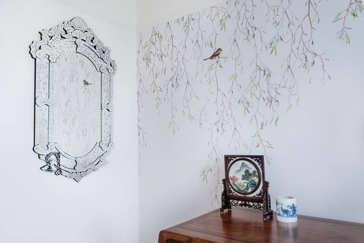 Venetian mirror reflecting the weeping willows in second bedroom