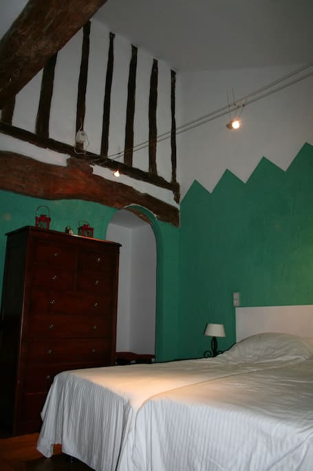 Chambre Verte with hardwood floor, oak beam ceiling with en suite bathroom
