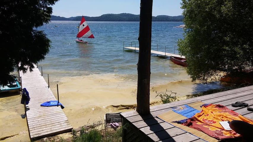 Beach front cottage on warm Lac Heney in QC