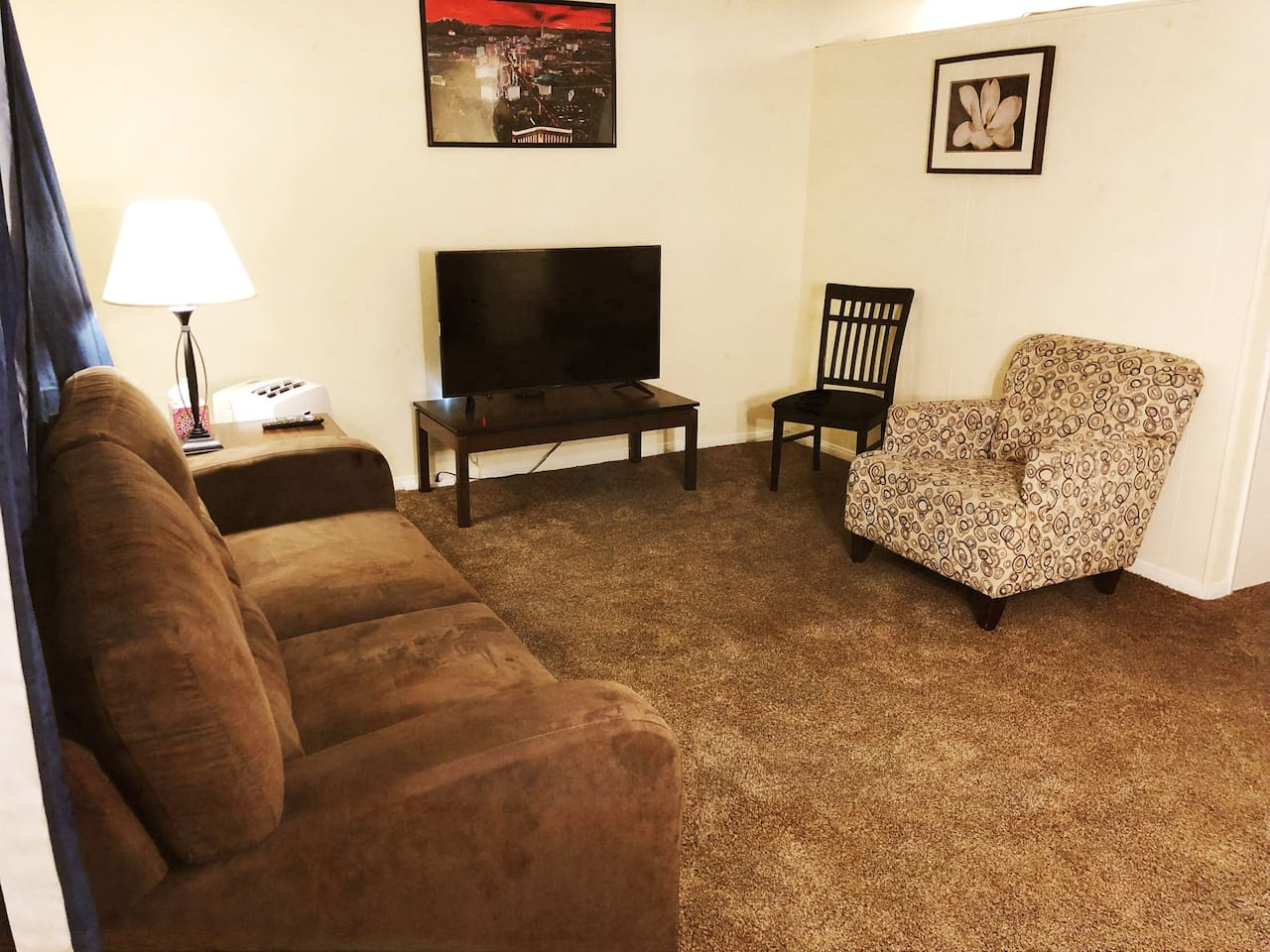 Living room with 50 inch smart TV & pull-out sleeper sofa