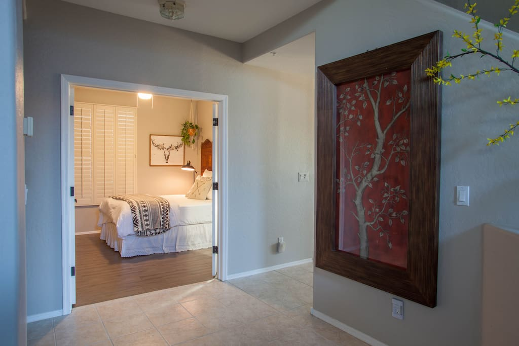 From the front door, enter your room through the double doors on the left.
