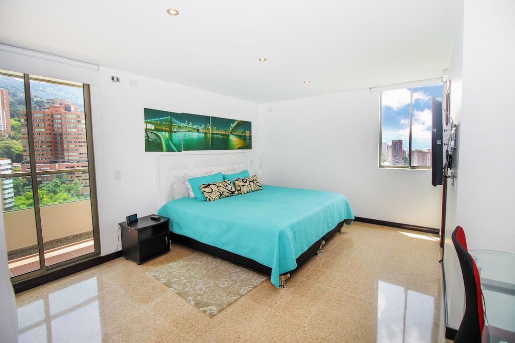 Master Bedroom with King size bed,flat screen tv,private bath and Balcony.