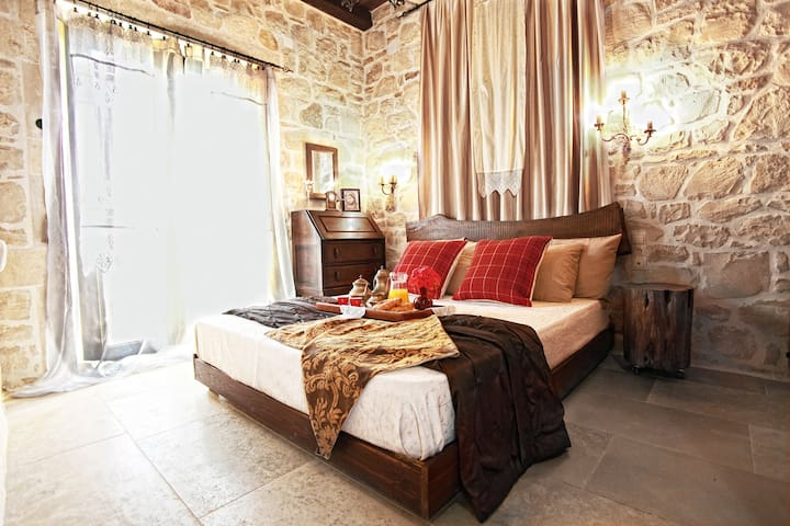 The master bedroom with balcony and sea view