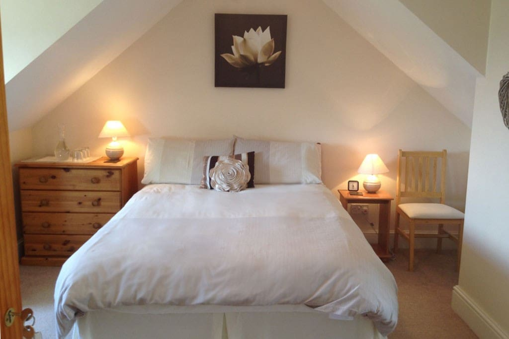 The room upstairs sleeps 3, with a double bed, a single bed, and en-suite shower room. There is also a downstairs room with private shower room.
