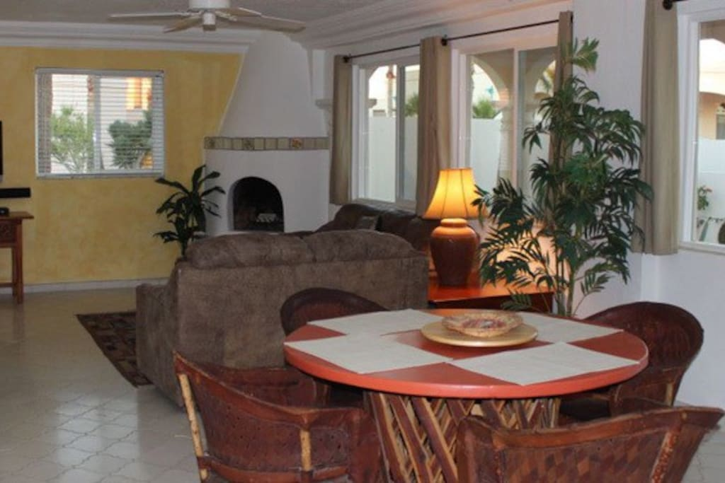 Open Dining and Living area  with HD TV with Satellite  TV & Music service