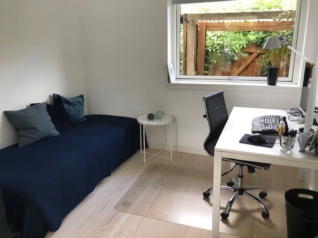 Guest room with office space