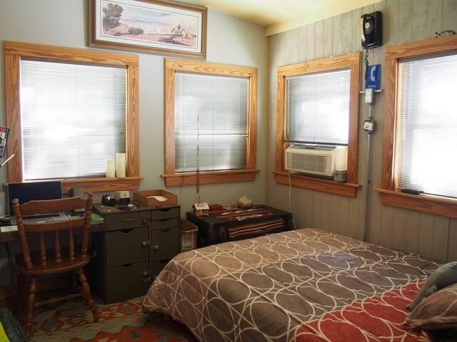 Bedroom 3 has a little desk/office area.