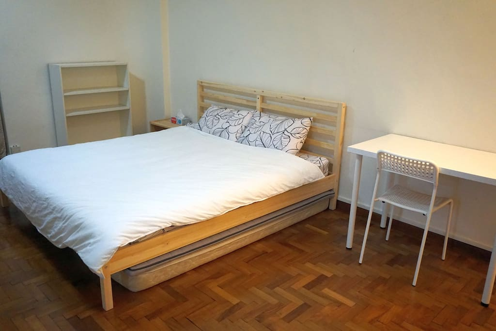 Additional single beds are under the large king bed.