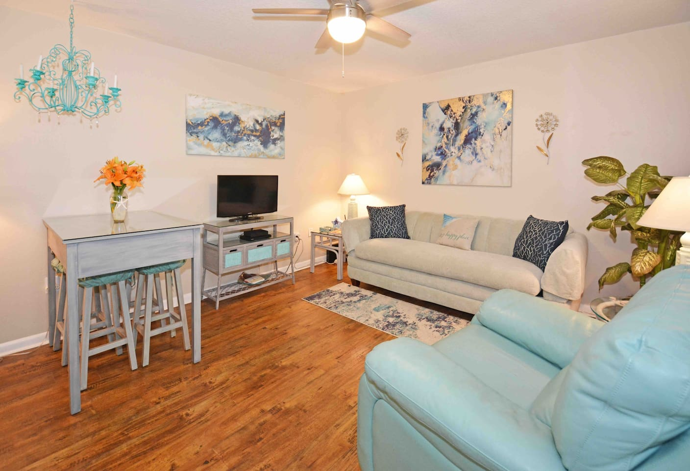 Beachy, contemporary, comfortable, and open living room with flat screen Smart TV w/cable, high speed internet, ceiling fan, and lamps with USB and outlets in them for your convenience. Queen sleeper sofa and dining table seats four.