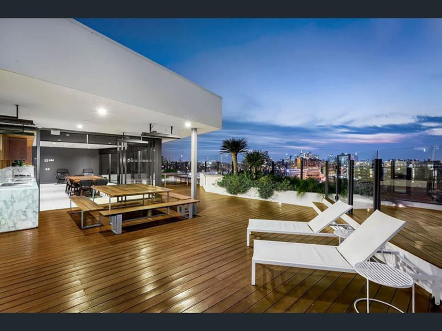 Roof top entertainment area with dining and TV room.