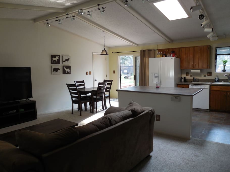 The main level has an open kitchen, dining area and living room.