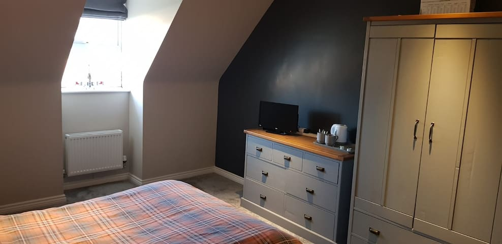 Large double room to rent in village home.