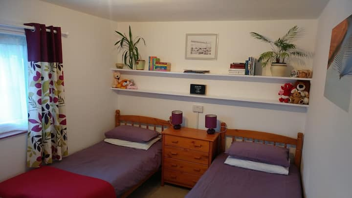 "Bright, sunny twin/double room with 42"" tv."