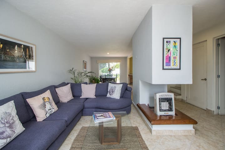 Living room. On the back end dinning room and terrace -steps away from community pool.