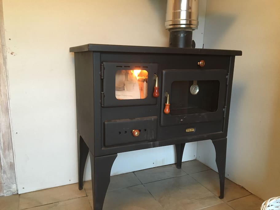 A wood burner to keep you warm, and you can cook your diner on it as well!