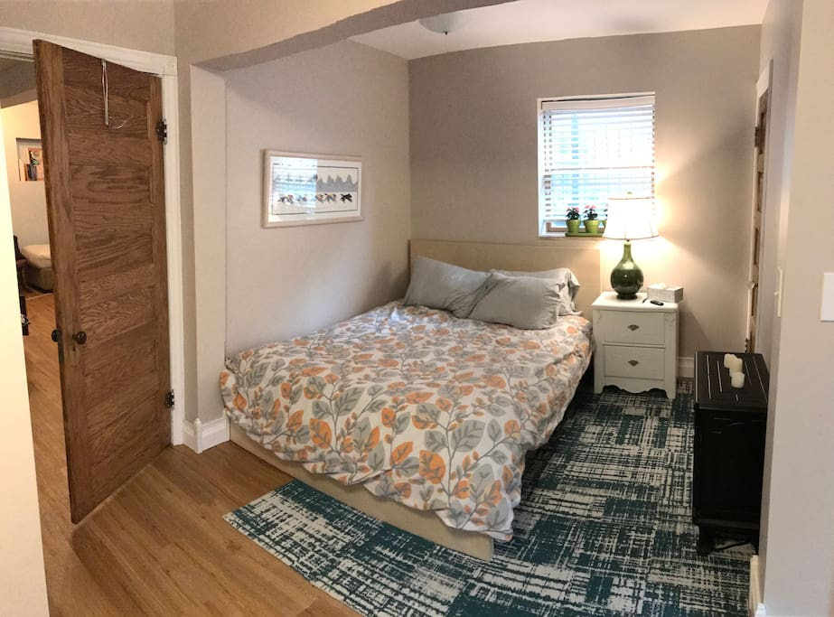 Bedroom with super comfortable queen-sized bed, electric fireplace and couch.