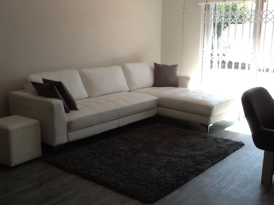 Lounge with flat screen TV with DSTV and PVR as well as DVD player