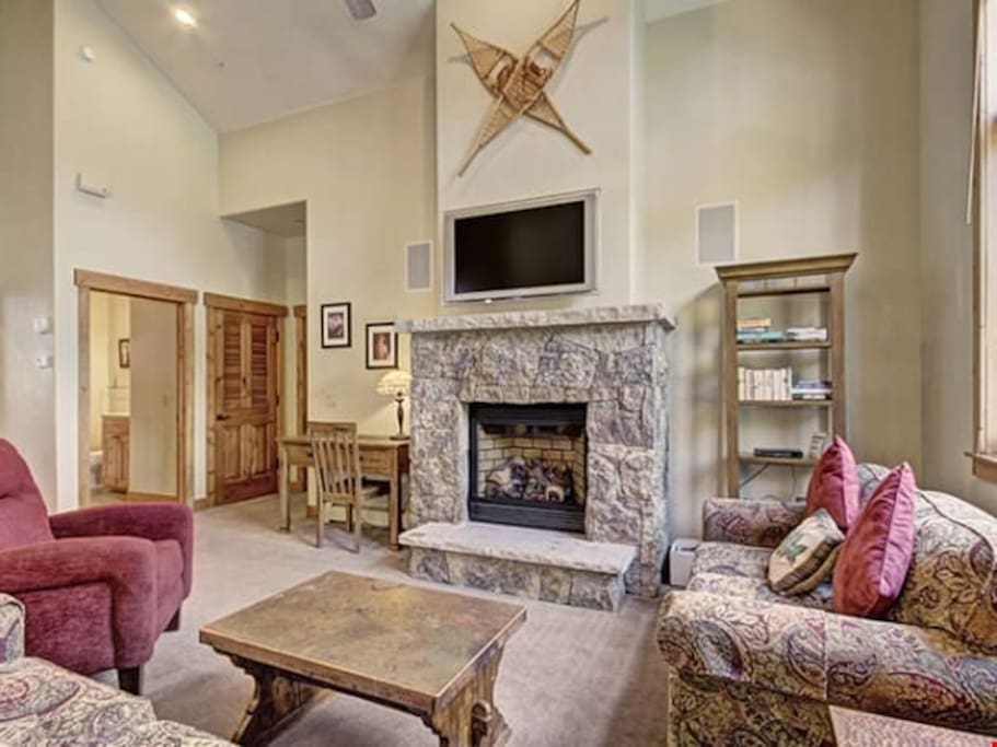Kick back your feet and relax in the spacious, bright living room.