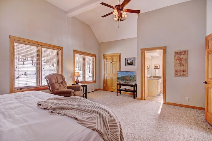 Upper level master bedroom with king bed and en suite bathroom.