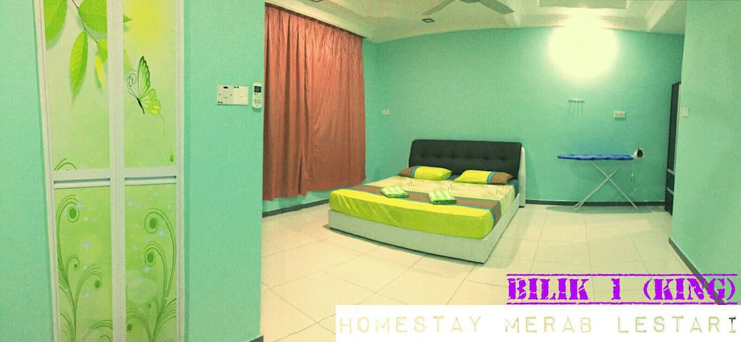 Master Bedroom with King Bed c/w airconditioning, ceiling fan, iron, iron board, wardrobe and personal toilet.