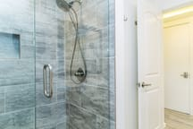 Completely rebuilt shower with frameless glass