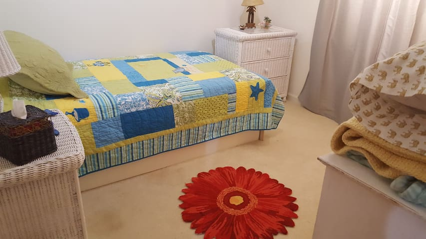 Single bed with roll out trundle. Redecorated seasonally! Sleeps 2