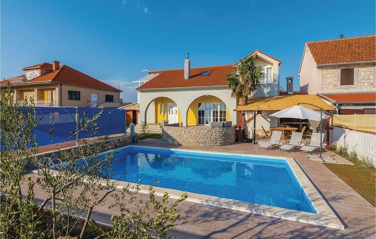 Beautiful home in Oklaj with Outdoor swimming pool, Outdoor swimming pool and 2 Bedrooms