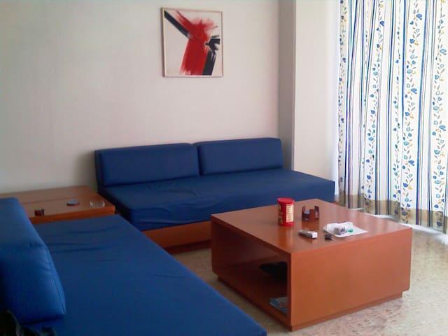 Sala con dos sofá-camas