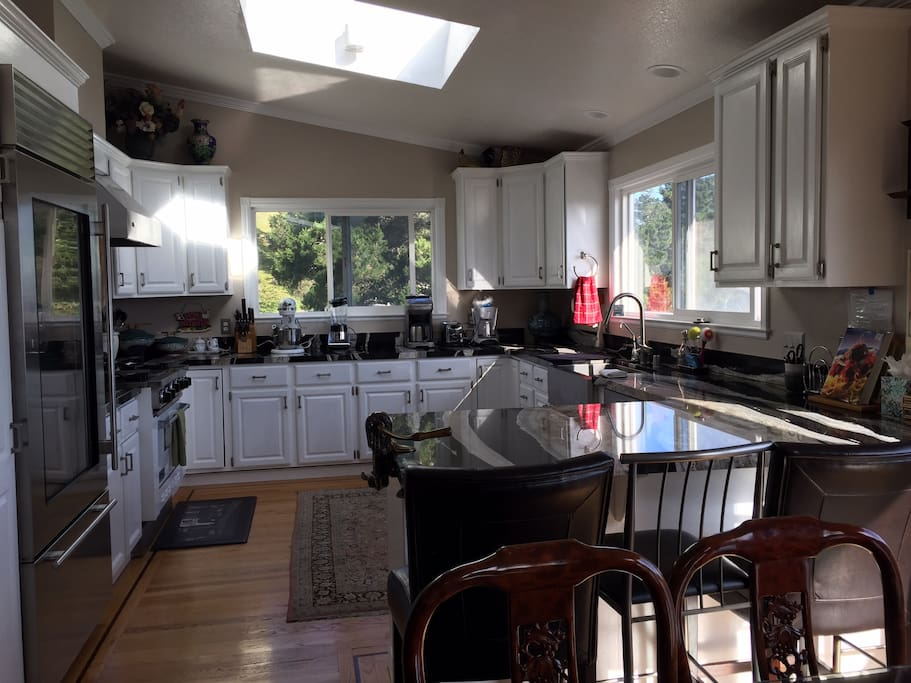 Large Kitchen with view of the ocean and trees, subzero ref and viking gas stove/oven
