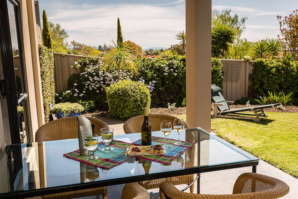Large table under cover - have a barbeque if you want.  Sunny garden