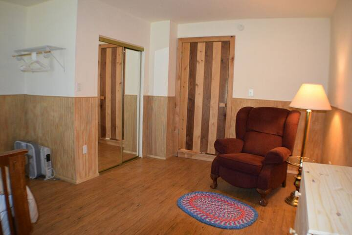 Master bedroom with recliner.