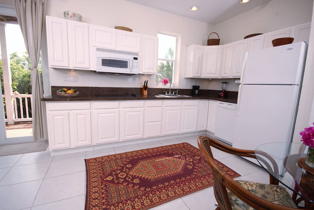 Fully equipped kitchen with doors opening to the balcony