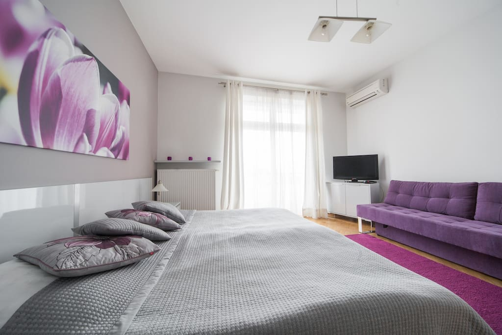 Bedroom with two single beds( or one double), sofa bed and TV.